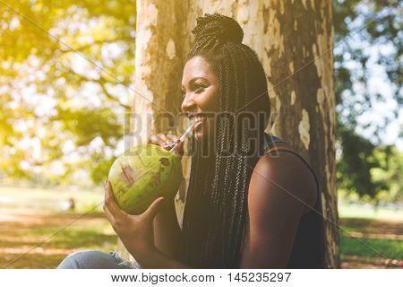 Latina woman enjoying a hot day in the park