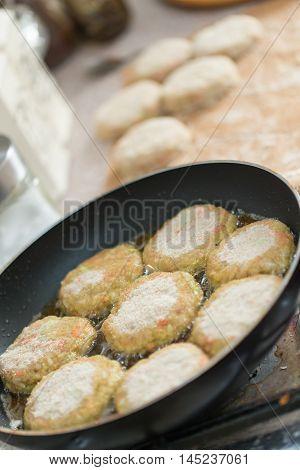chops on a black frying pan. dinner