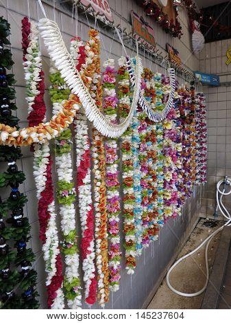 HONOLULU - DECEMBER 8: rows of Colorful Hawaiian flower lei for sale at Honolulu International Airport on December 8 2015 Honolulu Hawaii.
