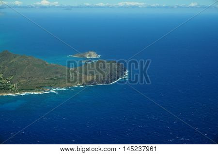 Aerial view of Sandy Beach Rabbit and Rock Islands Makapuu Point clouds and Pacific Ocean on Oahu Hawaii. On a spectacular day.