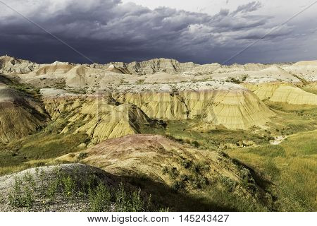 Badlands landscape and Storm Clouds in South Dakota, Badlands National Park