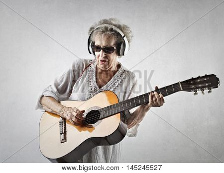 Grandmother acting like a rock star
