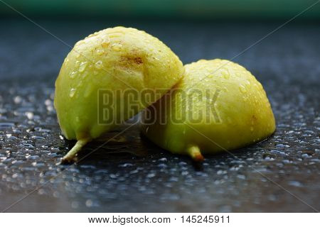 A pear cut into half. Waterdrops on pear slices.