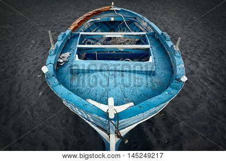 Blue sicilian wooden boat on the beach Sicily Italy