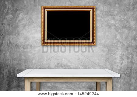 Empty Stone Table And Gold Vintage Wooden Photo Frame Hang On The Wall. Interior Decoration And For