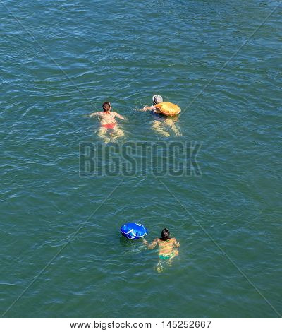 Basel Switzerland - 27 August 2016: people swimming in the Rhine river view from the Johanniterbruecke bridge. Basel is a city on the Rhine river in northwestern Switzerland situated where the Swiss German and French borders meet.