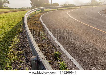 Turn in the road with guardrail. edit warm tone
