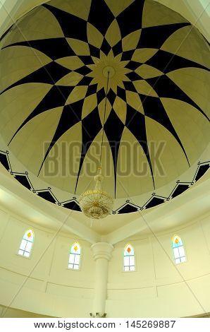 MALACCA, MALAYSIA -JANUARY 26, 2014: Decoration inside main dome of Malacca Straits Mosque at Malacca, Malaysia. Built on the on edge of the man-made Island, Malacca Island.