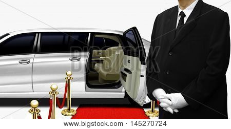 Chauffeur standing by the white limousine over white