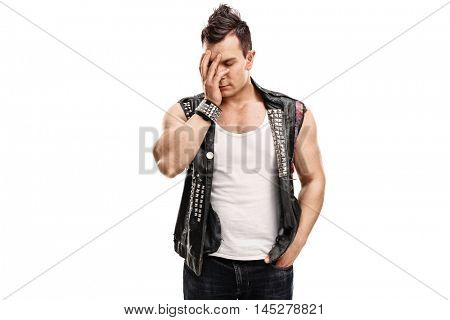 Upset punker holding his head in disbelief isolated on white background