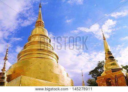 Uprisen angle of Thai golden buddism pagoda under deep blue sky