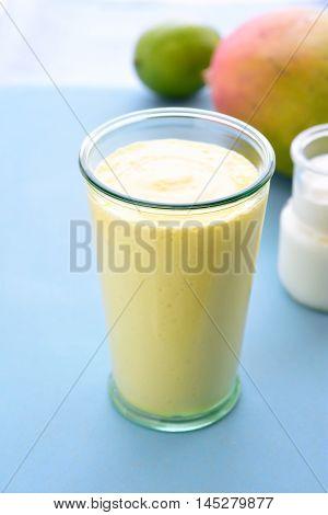Mango lassi. Mango smoothie made with mango and yogurt yoghurt. Selective focus. Angle view.