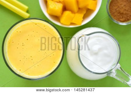 Mango lassi. Mango smoothie made with mango and yogurt yoghurt. Selective focus. Top view.