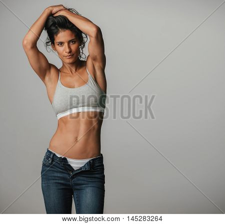 Powerful Athletic Woman Poses With Arms Above Her