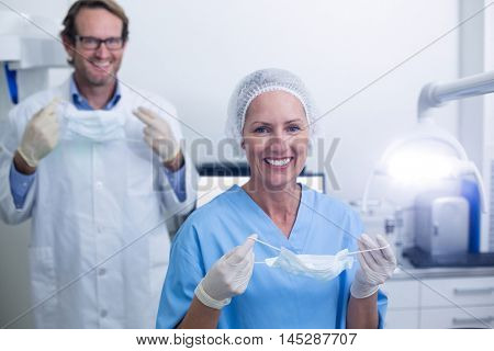Portrait of dentist and dental assistant in surgical mask at the dental clinic