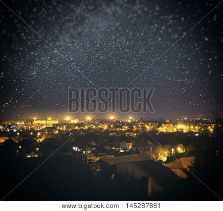 Beautiful starry night above the bright city