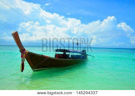 Long tailed wooden boat in Bamboo beach, Phuket Island, Thailand.