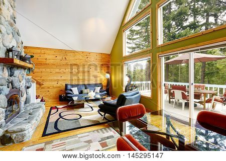 House Interior With Vaulted Ceiling And Glass Wall