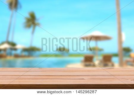 Wooden shelf and sea side resort on background.
