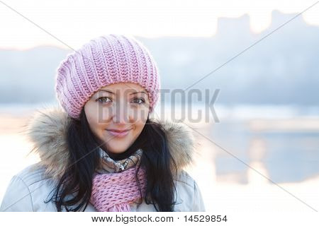 Positive Smiling Girl In Winter Clothes On Sunset