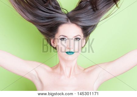 Girl Throwing Hair Up As Beauty Posing Concept