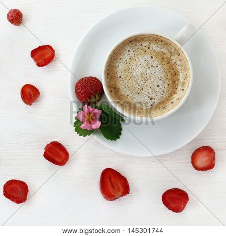flat lay background with red strawberries and frothy coffee top view / strawberry and coffee