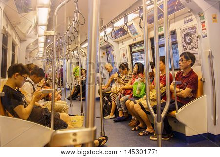 BANGKOK - NOVEMBER 8: People ride in BTS Skytrain on November 8, 2015 in Bangkok Thailand. The service carried an average 600000 passengers per day in 2012.
