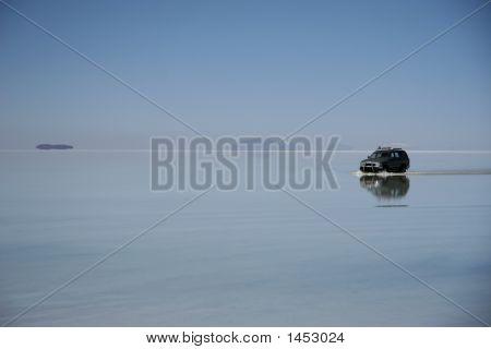 Water Mirror In Uyuni Salt Flats. Bolivia.