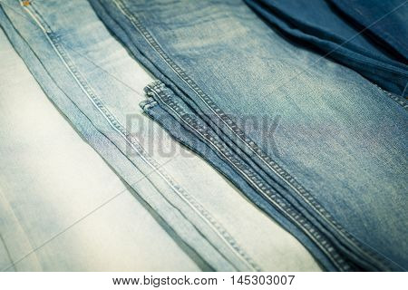 Close up shot of denim jeans in arow