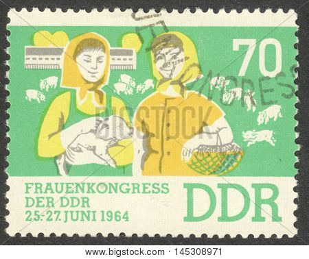 MOSCOW RUSSIA - CIRCA AUGUST 2016: a stamp printed in DDR dedicated to Womens Congress circa 1964
