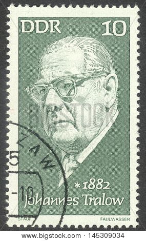 MOSCOW RUSSIA - CIRCA AUGUST 2016: a stamp printed in DDR shows a portrait of Johannes Tralow the series