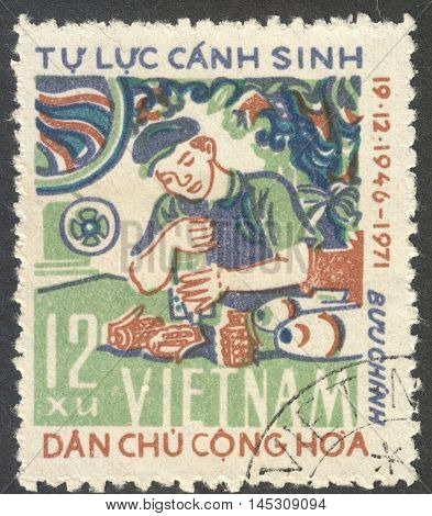 MOSCOW RUSSIA - CIRCA AUGUST 2016: a stamp printed in VIETNAM shows a munition worker the series
