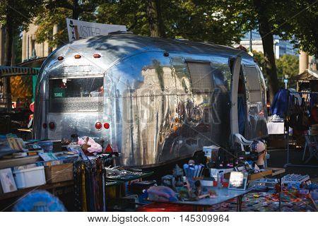 Berlin Germany - August 28 2016: Mirror old bus parked at a flea market in Berlin
