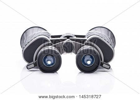 Single black pair of binoculars isolated on a white background.