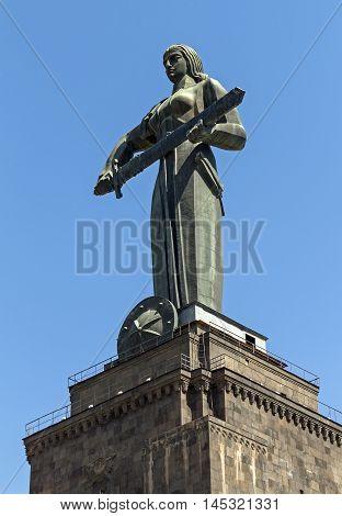 Yerevan,Armenia - August 22, 2016:Tourist's visiting main Yerevan landmark -Mother Armenia Statue or Mayr hayastan. Monument located in Victory Park Yerevan city, Armenia.