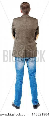 Back view of handsome business man in jacket .  looking ahead of yourself.   Standing young guy in jeans and suit jacket. Rear view people collection.  backside view of person.  Isolated over white