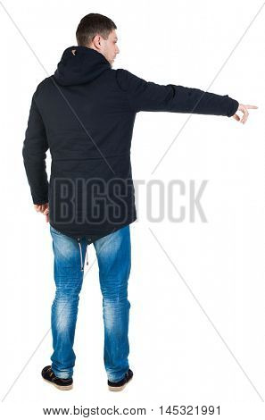 Back view of pointing man in winter jacket  looking up.   Standing young guy in parka. Rear view people collection.  backside view of person.  Isolated over white background. view; watching; pointing