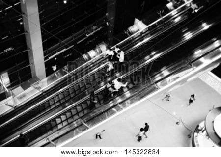 People on escalator Intentionally blurred editing post production. black and white picture style