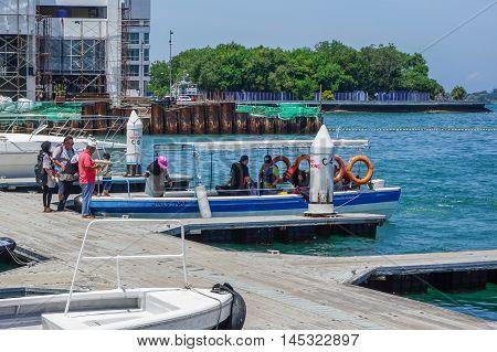 Kota Kinabalu,Sabah-Aug 30,2016:Tourists on the speedboat at Jetty Jesselton Point,Kota Kinabalu,Sabah.This jetty provided tourists facilities to the islands in Tunku Abdul Rahman Marine Park nearby.