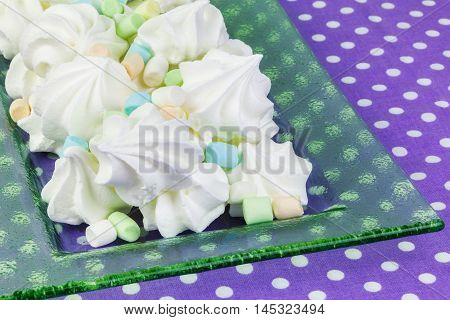 Meringue cookies on table in backgrounds .