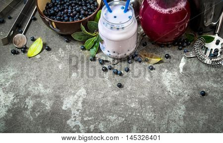Blueberry with blueberry smoothies and juice. On the stone table.
