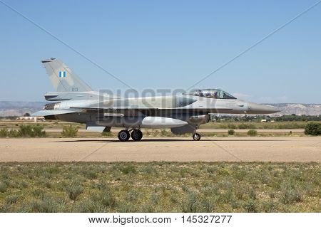 ZARAGOZA SPAIN - MAY 20 2016: Greek F-16 fighter jet taxiing after landing on Zaragoza airbase.