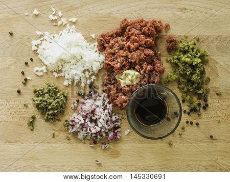 Mixing Steak Tartare Ingredients In A Bowl