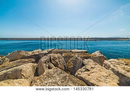 a breakwater in Alghero harbor in Sardinia