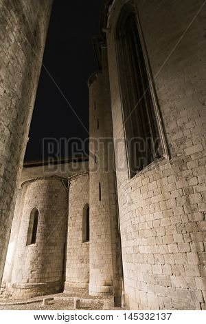 Girona (Gerona Catalunya Spain): old typical street by night. Apse of gothic church