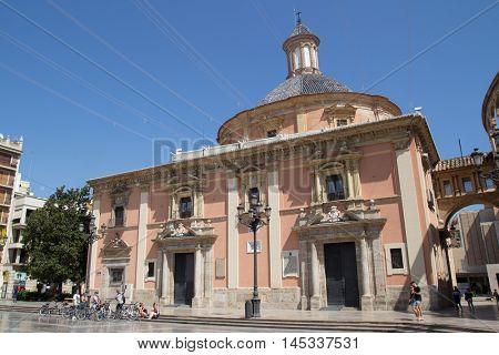 VALENCIA, SPAIN - SEPTEMBER 1, 2016: Tourist in front of the Basilica de la Virgen de los Desamparados Church. The church was built upon the ruins of a Roman forum.