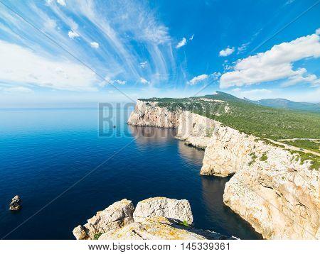 striped clouds over Capo Caccia in Sardinia
