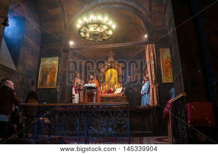 ARARAT, ARMENIA - MARCH 24, 2016: Easter service with armenian catholics inside the Khor-Virap monastery located close to Artashat