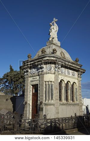 White marble mausoleum in the historic cemetery of Punta Arenas in the Magallanes Region of southern Chile