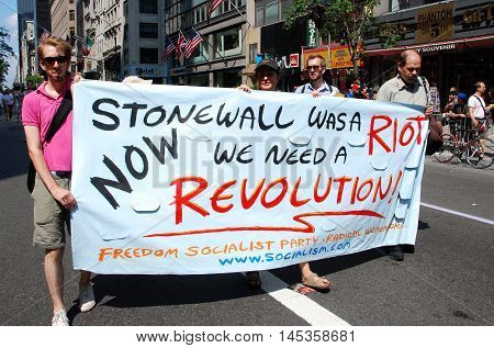 New York City - June 28 2009: Marchers holding a Stonewall banner at the 40th anniversary gay pride parade on 5th Avenue